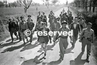 Italian partisani on the move near the Reno River in Italy 24 April 1945