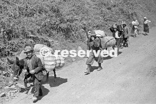 Italian partisani on the move near the Reno River in Italy